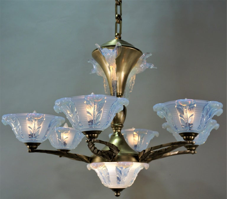 French Art Deco bronze chandelier with feather design opalescent glass flying birds. Original condition. Total height including all the chain is 46