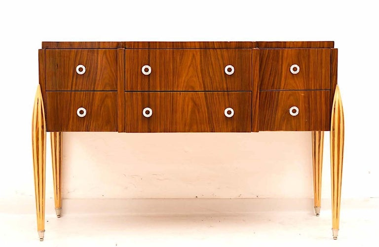 Art Deco dresser with six drawers and hammered brass hardware inlaid fluted legs. This commode an elegant look offer ample storage space is in perfect vintage condition.