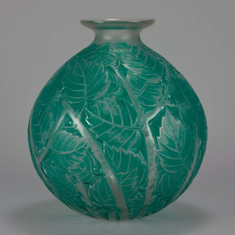 """Impressive early 20th century clear and frosted Art Deco glass vase decorated with raised leaves heightened with green staining, signed R Lalique - France  Milan Catalogue Number: 1025 Signature identification: """"R. Lalique - France"""" Script"""