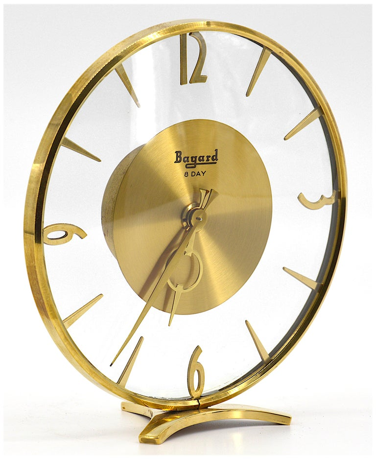 Art Deco table clock by Bayard, France, 1930s. Brass and glass. 8 days movement. Measures: Height 6.7