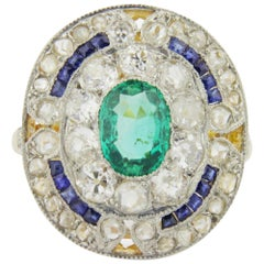 French Art Deco Cocktail Ring with an Emerald, Diamonds and Sapphires