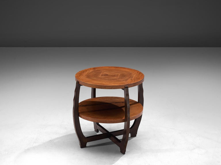 Coffee table, walnut, France 1940s  This playful sidetable has two round table tops, with well executed in stunning mirrored veneer.The warm color of these round shaped table tops is contrasted by the dark frame and legs. The frame has an open