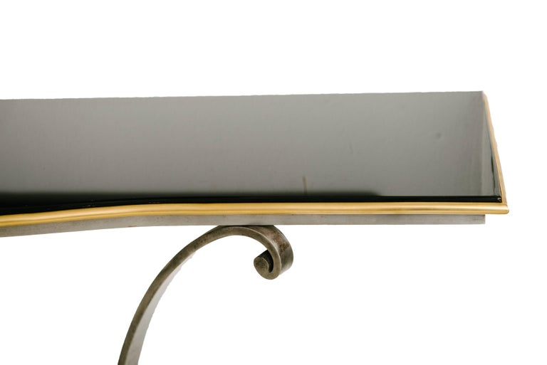 French Art Deco bronze, steel and wood console with black glass top by Raymond Subes, circa 1925.