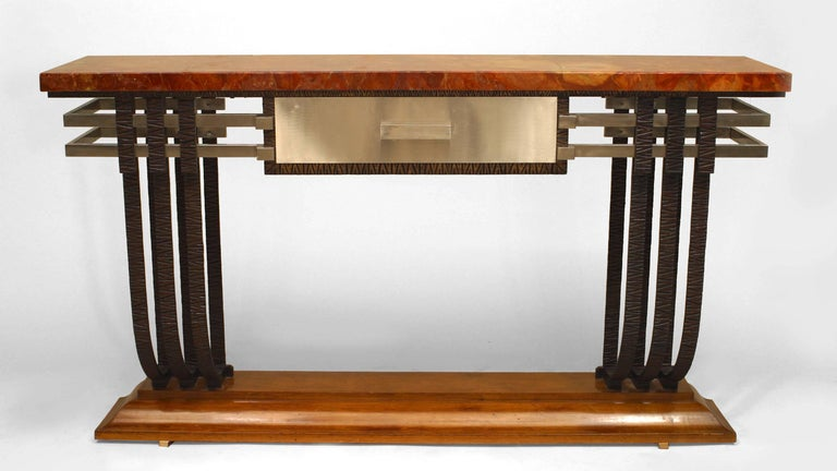 French Art Deco iron and steel trimmed console table featuring two groups of modern iron scrolls supporting a rust marble top and steel drawer while resting upon a mahogany base.
