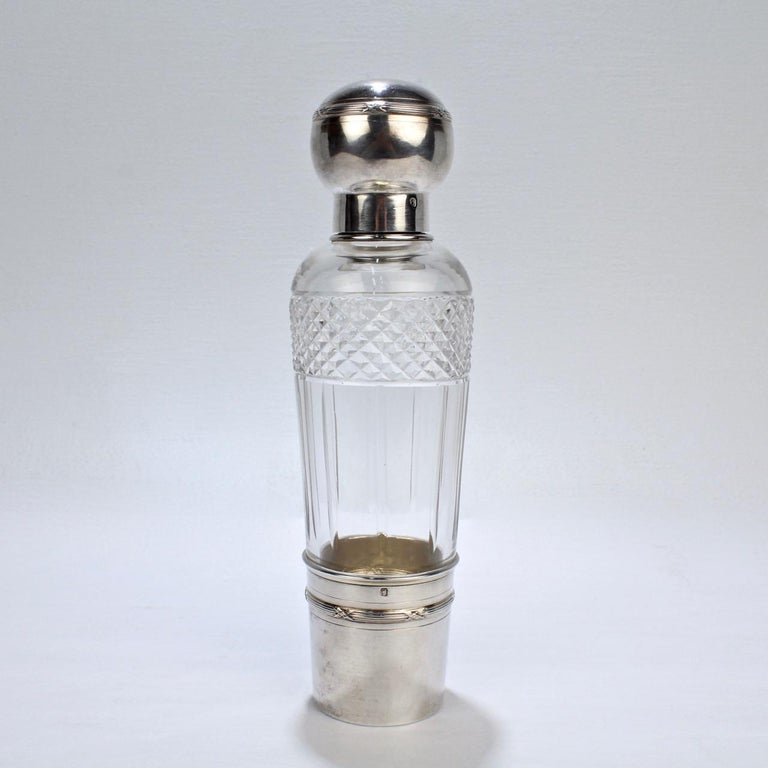 A very fine French Art Deco Flask by the Parisian jewelry maker and silversmith Albert Chambin.  In cut glass and sterling silver with a removable cup, twist-top cover, and glass stopper.  The silver hallmarked with a Medusa's head for silver