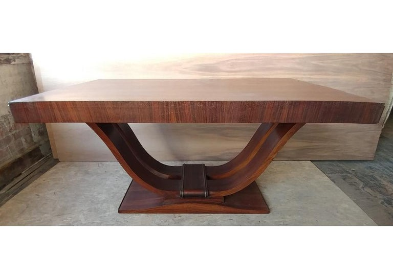 This stunning French Art Deco harp shape table from 1935 is part of a complete Dining room set. Can be used for dining or as an impressive desk or a small conference table. Constructed from solid wood with mahogany veneers. The top has two