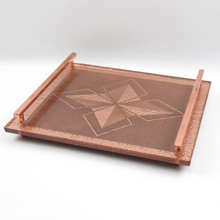Lovely French Art Deco copper and peach mirrored tray. Elegant thick glass slab in copper peach color with reverse geometric etching and star design. Large copper handles on both side. Perfect for dresser as well as barware or cocktail party. No