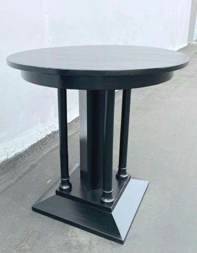 1930s sofa table or side table ebonized finish. Walnut table with central square leg with the four wood legs stands.