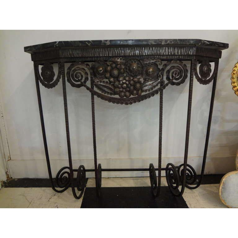 Beautifully detailed Edgar Brandt or Paul Kiss inspired French Art Deco hand forged and hammered wrought iron console table. This stunning French deco wall mount console table or demilune retains its original marble top and dates to the 1930s (great