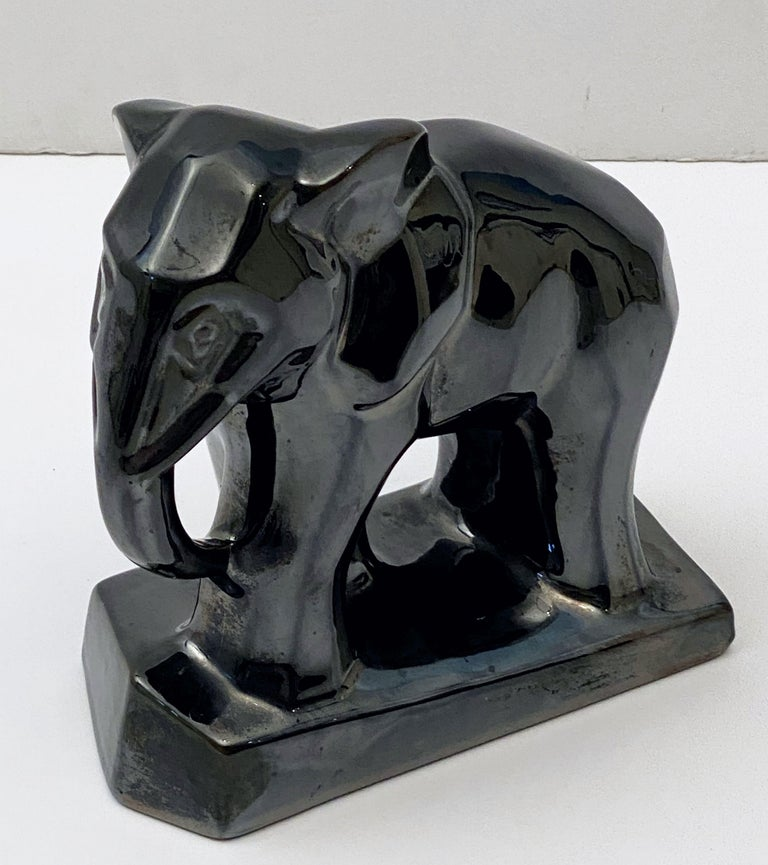 A fine French Art Deco elephant figurine in the cubist style with a lustrous, iridescent black ceramic glaze.