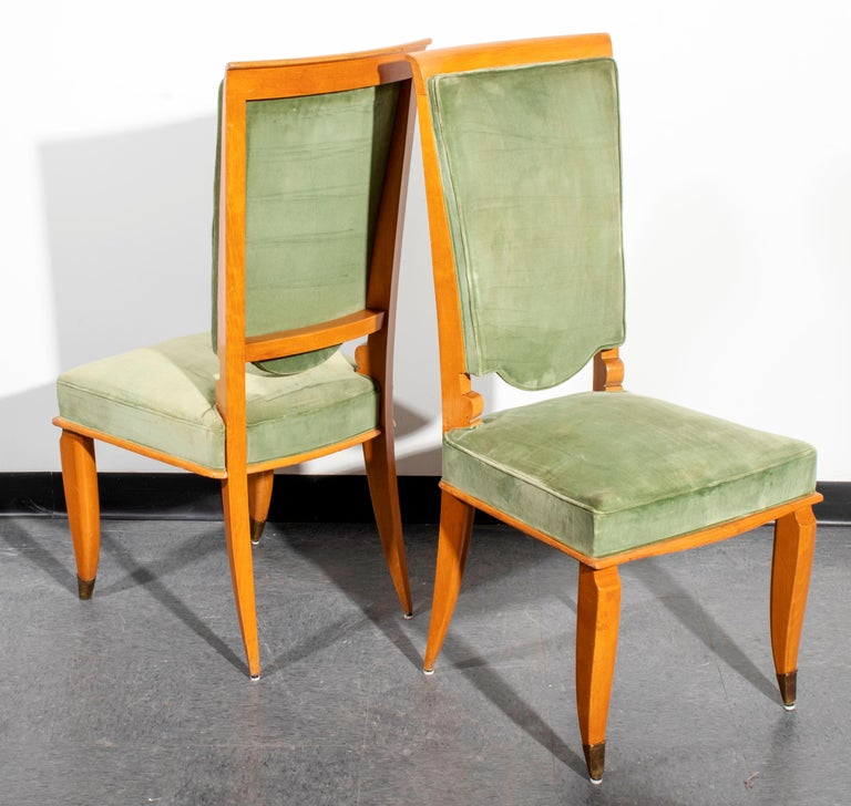 Set of six French Art Deco fruitwood dining chairs with green upholstery. Measures: 42