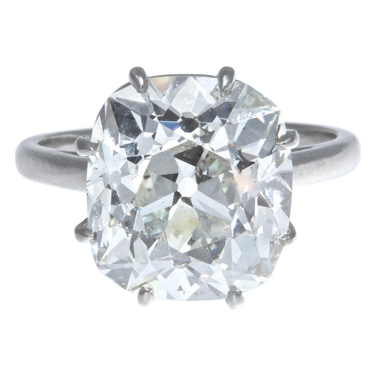 Simply put, this is The Perfect engagement ring. An incredibly fiery and brilliant 6.33 carat GIA certified old mine brilliant cut diamond steals hearts while providing more than ample finger coverage. This GIA certified old mine brilliant cut