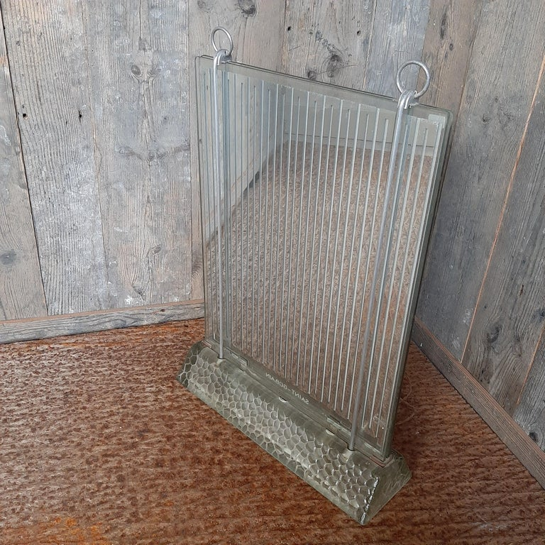 Glass radiator, model Radiaver designed by Rene Coulon (French architect) for Saint Gobain. Double glass plates and lighted feet. Designed in 1937 for the Industrial exhibition EDF Electropolis and manufactured until 1952. Dimensions: H 58 x W 42 x