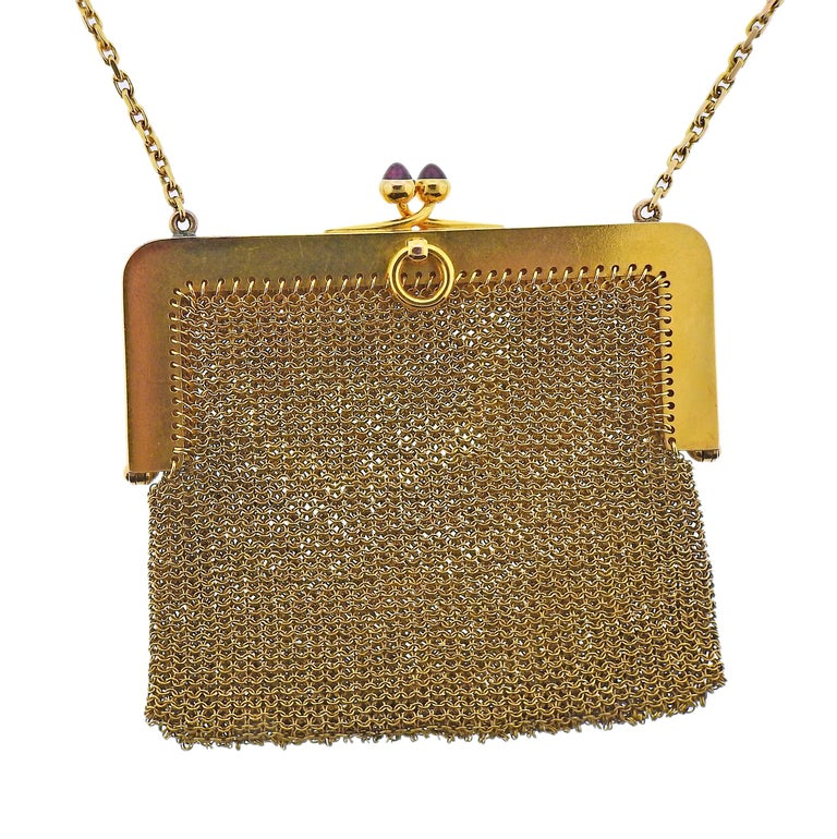 French made Art Deco 18k gold mesh purse, with two rubies on the clasp, decorate with rubies and diamonds. Purse is 2.75
