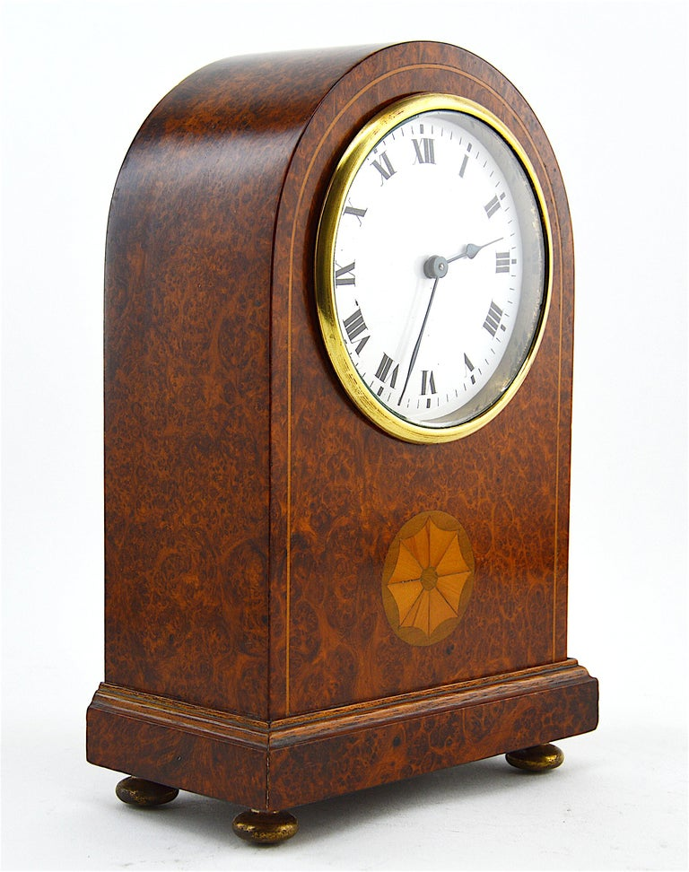 French Art Deco table clock in the style of Sue & Mare, France, 1920s. Inlaid amboyna veneered. Measures: Height 8.4