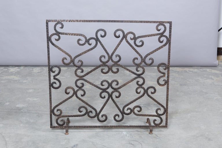 Art Deco French wrought iron fireplace screen with hand-hammered effect throughout. Purchased from the Parisian flea.