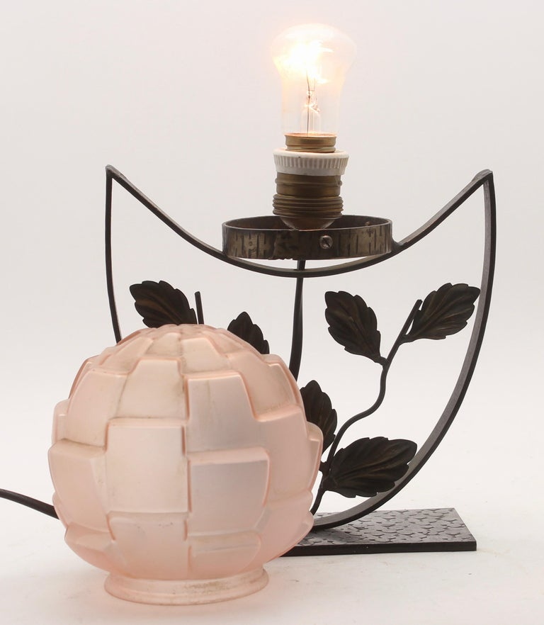 1938, France A wonderful of French Art Deco lamp. The stand are handmade in wrought iron with black finish patina and hammered with floral pattern. The metalwork is of excellent quality. They are crowned with colored shade  In excellent