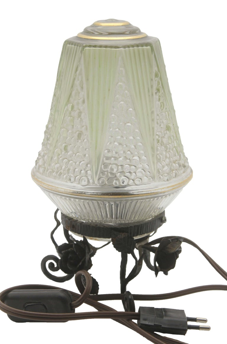 Art Nouveau French Art Deco Lamp in Wrought Iron with Floral Pattern and Colored Glass Shade For Sale