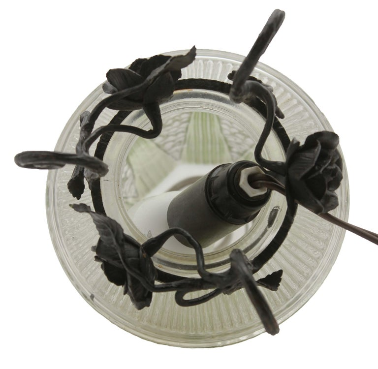 Early 20th Century French Art Deco Lamp in Wrought Iron with Floral Pattern and Colored Glass Shade For Sale