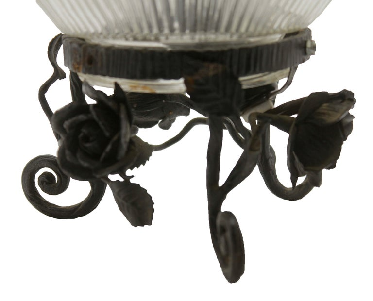 Art Glass French Art Deco Lamp in Wrought Iron with Floral Pattern and Colored Glass Shade For Sale