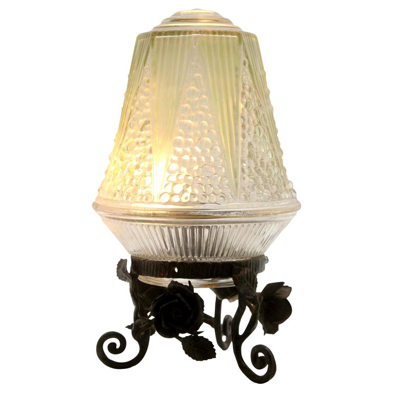 French Art Deco Lamp in Wrought Iron with Floral Pattern and Colored Glass Shade For Sale