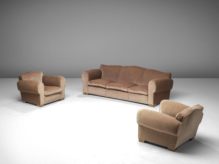 Living room set, velvet and oak, France, 1940s  Grand and comfortable three-seat sofa and two lounge chairs in taupe velvet upholstery. Truly extraordinary luxurious set that features a deep seat and voluptuous rounded, curved armrests. The