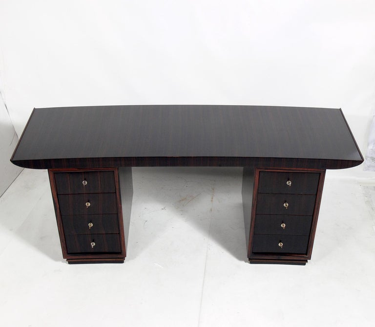 French Art Deco Macassar desk or bureau plat by Dominique, unsigned, France, circa late 1920s-1930s. Beautiful figured graining to the macassar ebony. Recently refinished and ready to use.