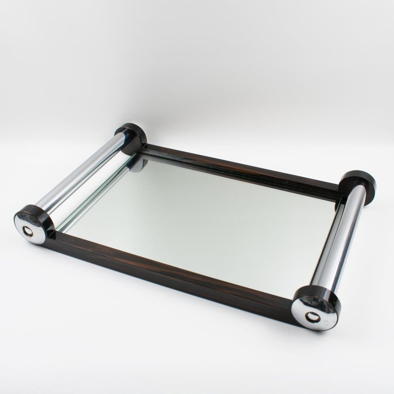 Large elegant rectangular French Art Deco barware serving tray. Chromed metal and Macassar wood gallery and extra thick handles. Insert base in mirror. Modernist design and geometric streamline shape offers all the elegance one could imagine for the