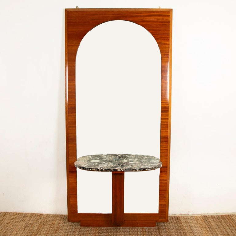 A pair Art Deco mahogany and Neropotoro marble mirrors, each with a built in console/shelf.  The width of each mahogany mirror frame is slightly different, one is 41 inches - 103.5 cm in width, the other is 39.5 inches - 100.5 cm. (height: 85