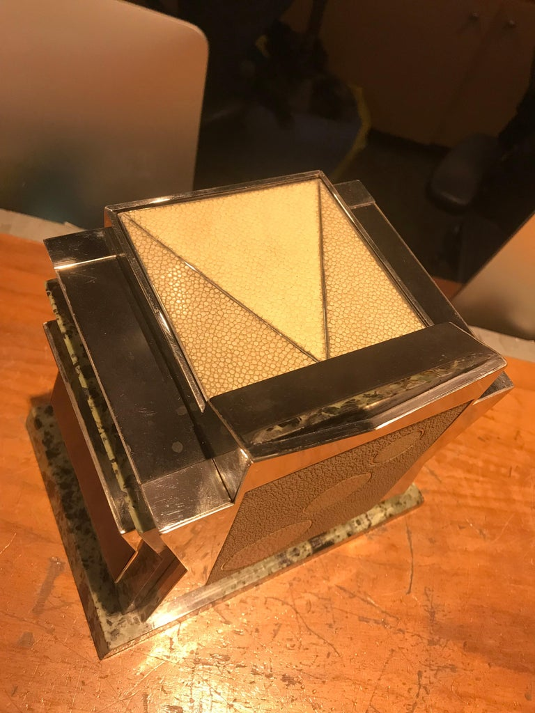 This magnificent box is truly an object of Virtue. Made from marble and accented with nickel and shagreen, this puzzle box has a secret opening when pressing upon the correct circle. It releases a lever and the top shoots open. To close, one must