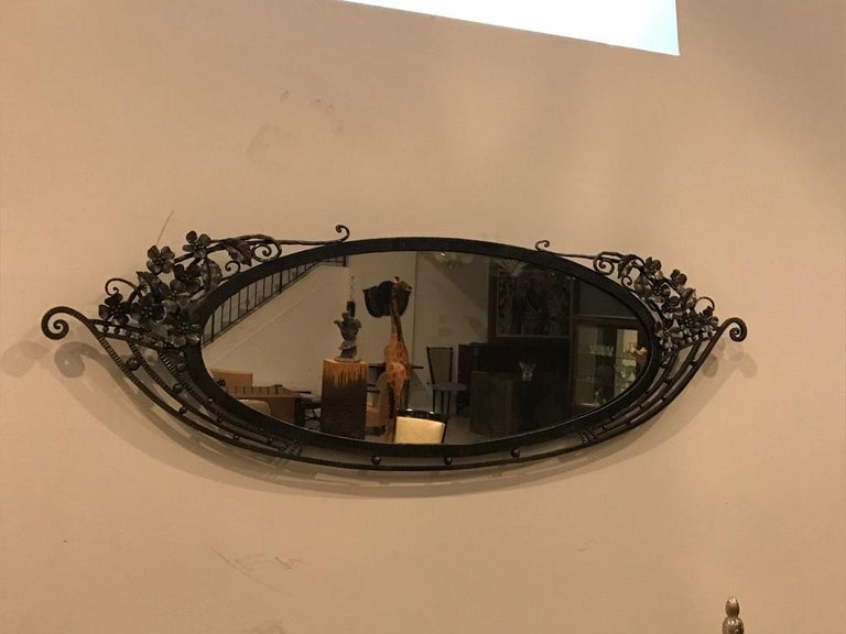 Stunning French Art Deco wrought iron floral mirror with beautiful Deco details. Can be re plated upon request.