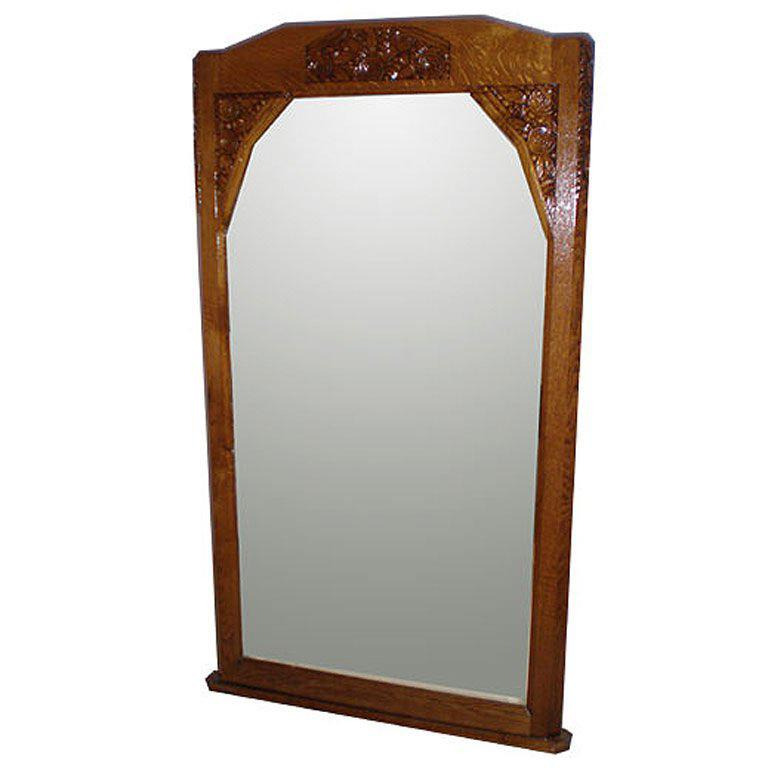 French Art Deco Mirror - large wall mirror with carved walnut trim and glass.   France circa 1930.