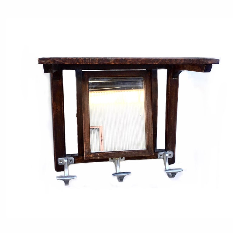French Art Deco mirrored coat rack. Orientable mirror with 3 metal coat hangers and top slatted shelf.