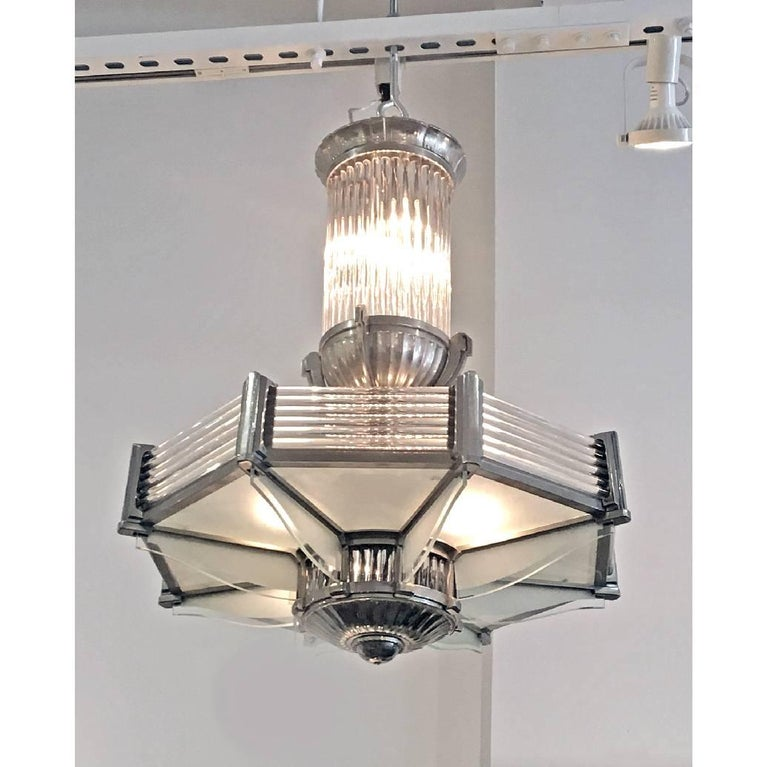 A French Art Deco nickel-plated metal frame chandelier by Atelier Petitot with frosted glass panels and glass rods. Made in France circa 1930 Signature: Petitot 1266.