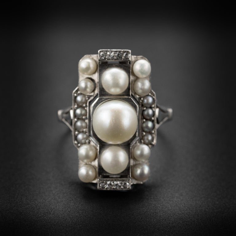 Created in France in the 1920s, this natural saltwater pearl and diamond ring is a geometric tour de force.  We've all seen Art Deco platinum and pearl rings. And we've all admired them. But have we ever seen one quite like this? Where the crisp and