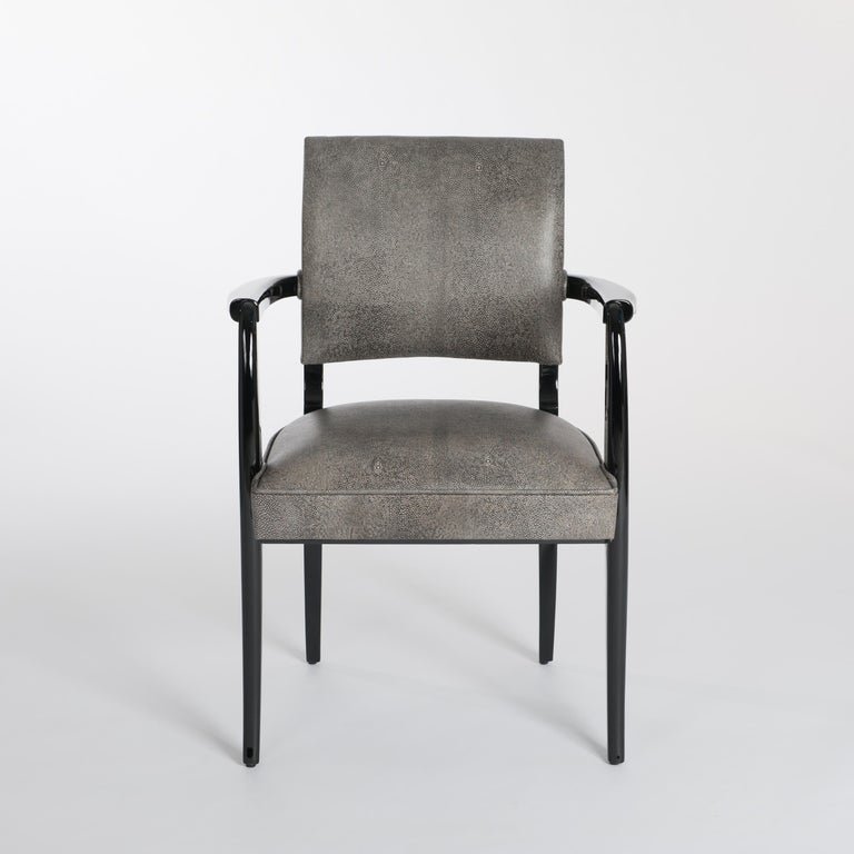 Elegant shaped French Art Deco office chair (armchair) restored. Re-lacquerd with black shiny gloss finish, re-upholsterd with black and white colored leather in raydesign.  With a special process a traditional nappaleather is printed in raydesign