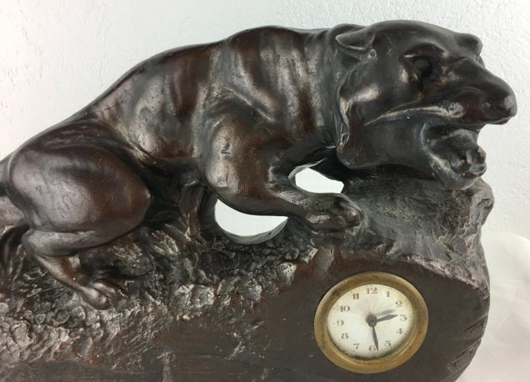 A beautiful French Art Deco enameled terracotta or possibly spelter panther sculpture and clock. Very good condition, circa 1930. Originates from the city of Nancy known for its Art Nouveau and Art Déco movement and styles, which was home to much of