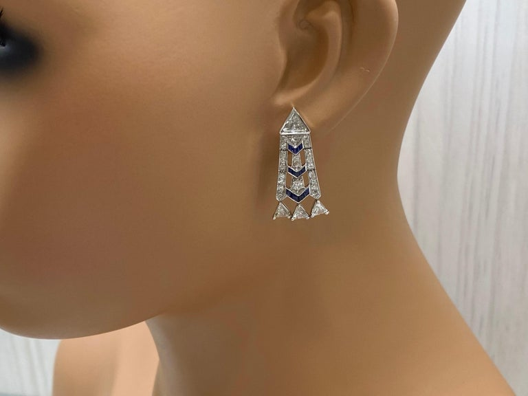 One of a kind is our specialty. These Mindi Mond exclusive are earrings derived from the Art Deco period and lovingly updated in 2019 for contemporary wear.  They are elegant and chic at the same time. The dangling triangular diamonds dangling from
