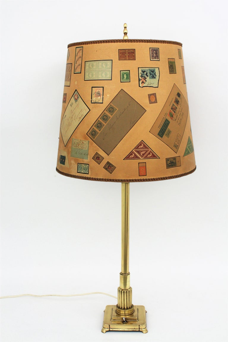 French Art Deco Polished Brass Column Table Lamp with Letters and Stamps Shade For Sale 1