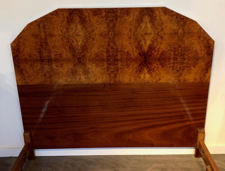 1930s French Art Deco bed frame. Spectacular exotic European bookmatched burl walnut. Converted to fit a standard queen size bed. Modernist design with stepped curved footboard and matching side rails. The centerpiece for the beginning of any