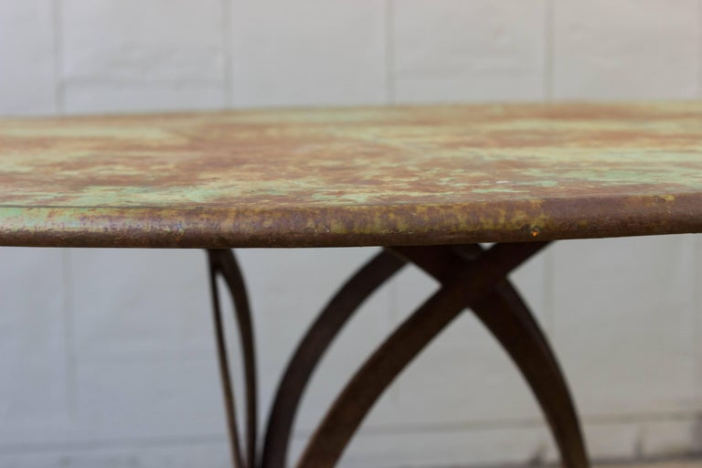 Early 20th Century French Art Deco Round Iron Garden Table with Abstract Base For Sale