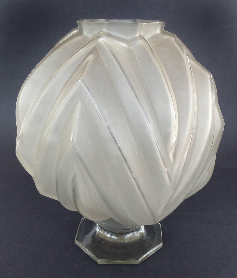 French Art Deco Sabino Glass Vase  Offered for sale is a French Art Deco acid frosted Sabino glass vase with an octagonal footed base. The base is marked Sabino France. The vase has a slight grey tone.