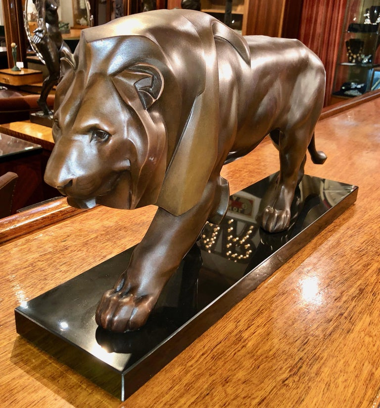 Art Deco sculpture of a walking lion by the famous French sculptor Max Le Verrier. Art metal of the highest quality with beautiful dark brown/bronze patina on a Belgian black marble base. Very impressive original statue from France circa 1920/1930.