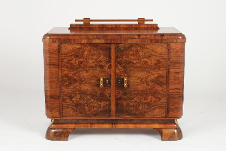 This French Art Deco Server has been professionally restored and is made out of walnut wood with its original finish that has just been newly waxed & polished. This Server has a unique design and features a wooden top and curved side design.- The