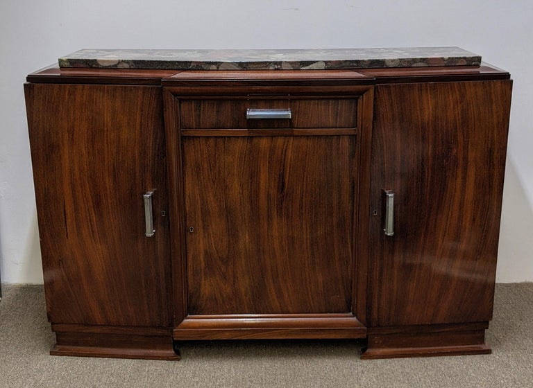 French Art Deco sideboard in walnut veneer marble top with Nickel hardware. Geometric modern clean line design accommodating three doors with a central draw.