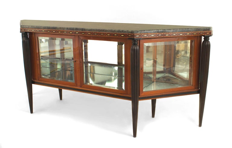 French Art Deco mahogany sideboard cabinet with 4 glass front doors and an intricately inlaid trim edge under a marble top with 4 tapered fluted ebonized legs (MAURICE DUFRENE)(DOCUMENTATION AVAILABLE).