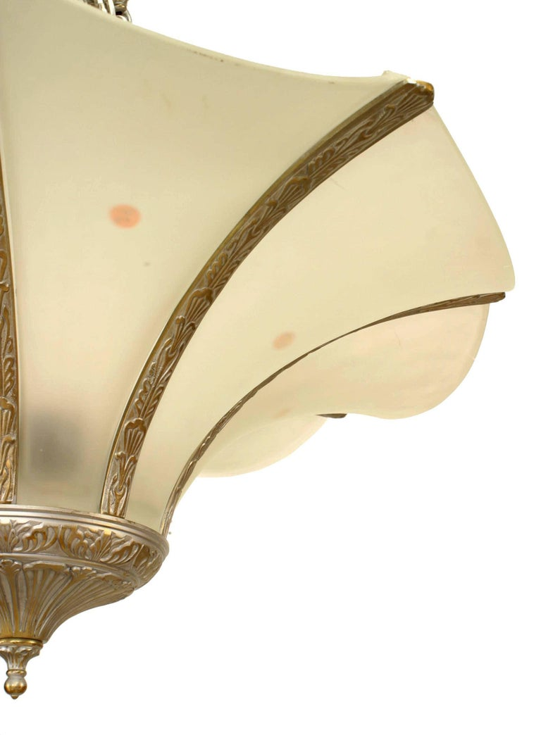 French Art Deco silver painted metal chandelier with eight flaired frosted glass panel shades.