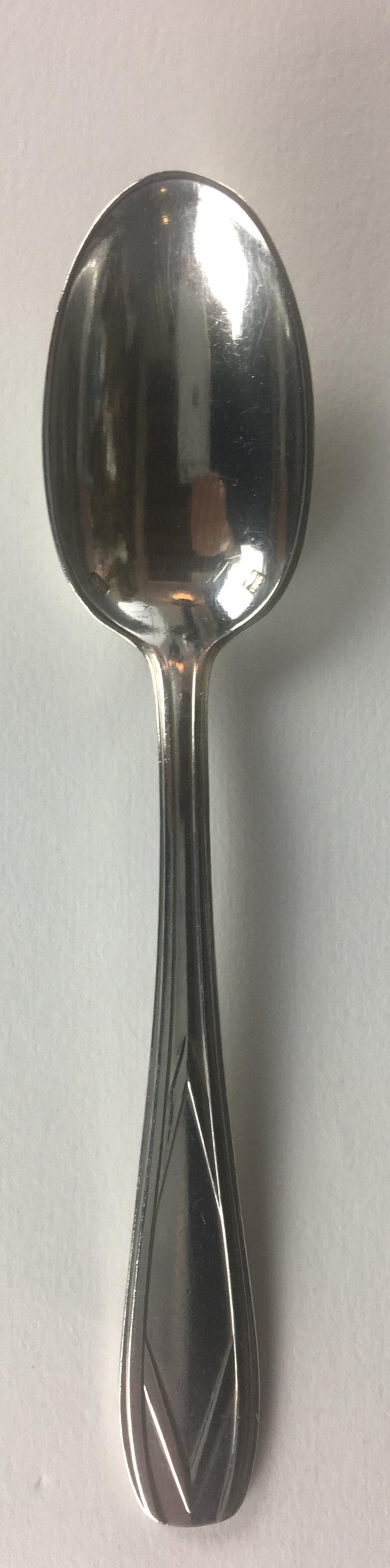 Twelve piece silver plated tea - coffee spoons set. Marked, this mark was found in many similar patterned items from the early 1900s-1930s. Sold in original box with dividers for each item, box marked Cholet. Patten unknown.   No monograms, elegant