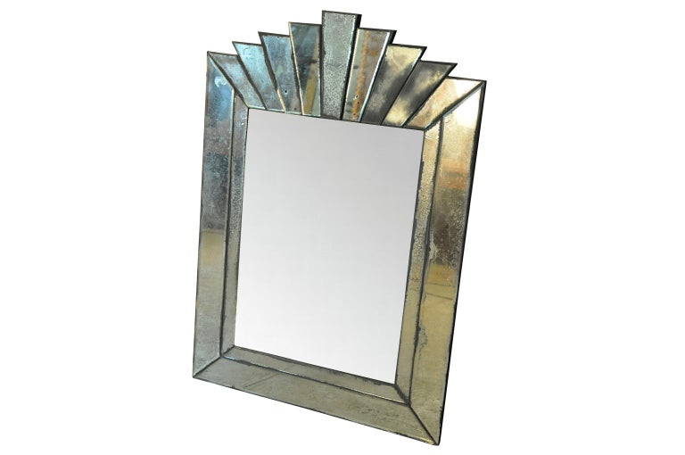 A very charming and elegant French Art Deco style mirror. Wonderful character with beautiful crazing. Please note that the central part of the mirror has been photo shopped.