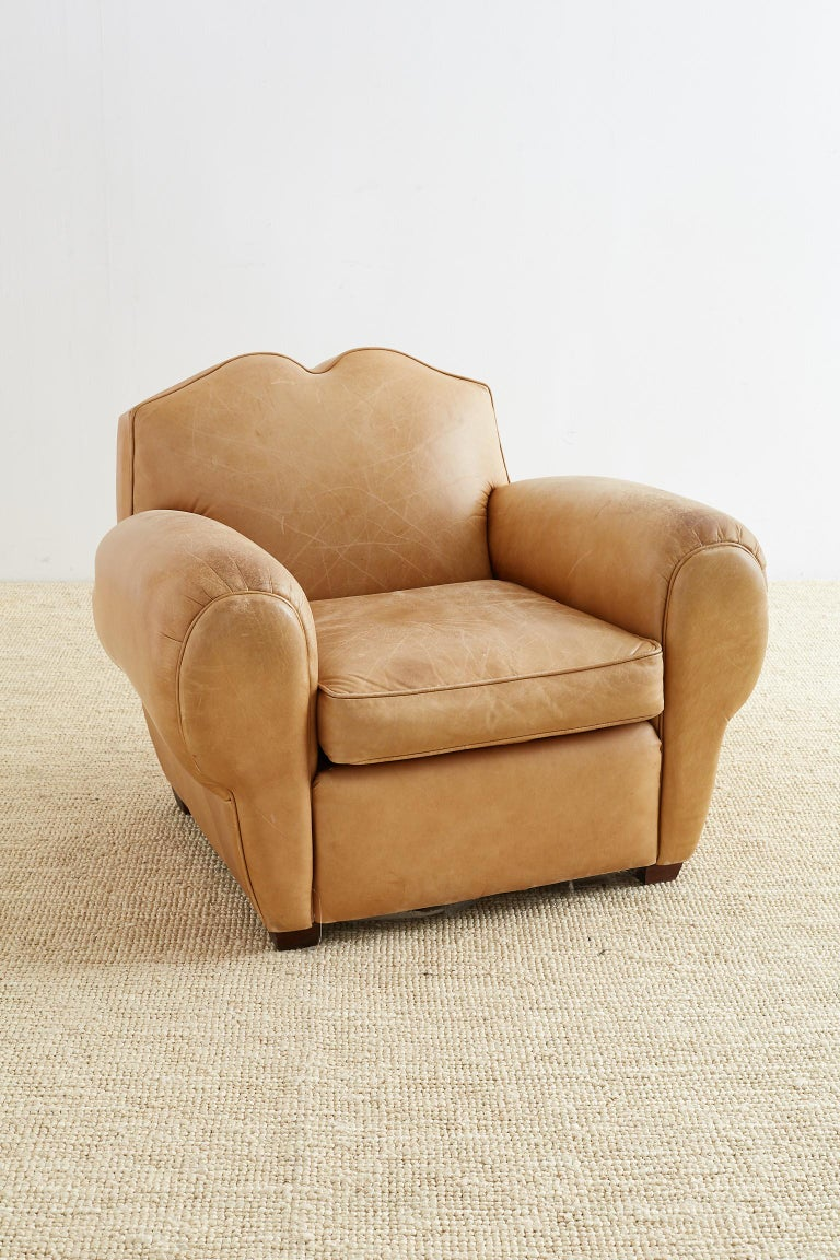 Grand French Art Deco style leather club chair made by Leathercraft. Beautifully constructed with a hardwood maple frame and covered with 100% top grain leather hides. Features a distinctive French mustache seat back and large balloon arms.
